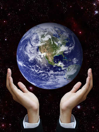 brotherhood: Hand holding earth (Earth view image from http:visibleearth.nasa.gov