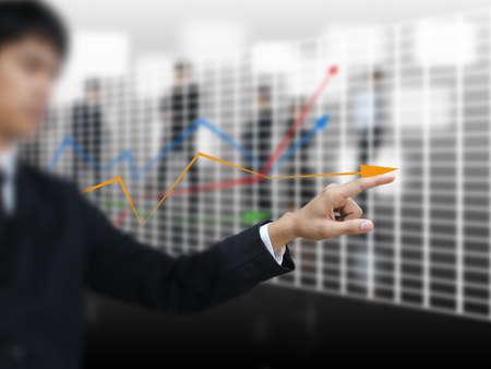 Business man point graph photo