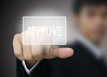 approve icon: Businessman press approve button