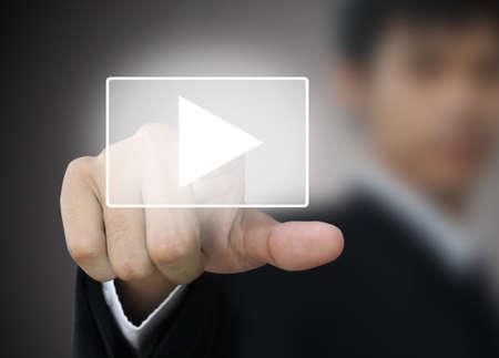 Business hand press play button