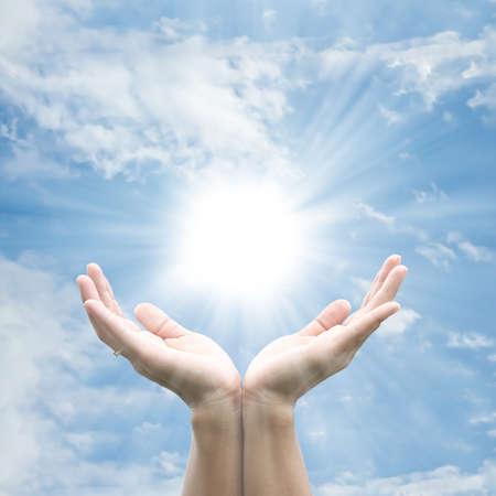 Hand holding the sun photo