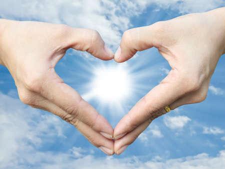 Hand make heart sign photo