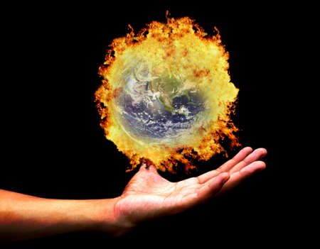 Hand holding burning earth(Earth view image from http:visibleearth.nasa.gov ) Stock Photo