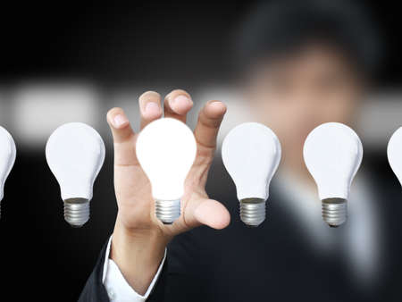 businessman holding lightbulb Stock Photo