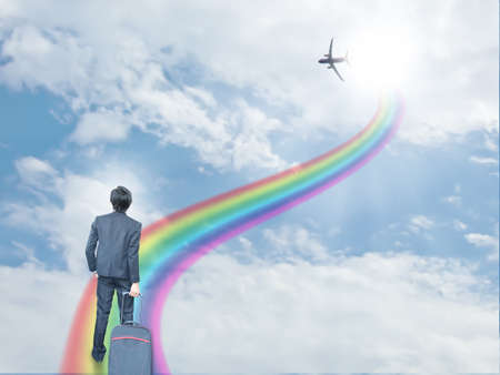 dream vision: Businessman on rainbow way Stock Photo