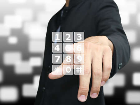 digital Numbers: Man press phone number Stock Photo