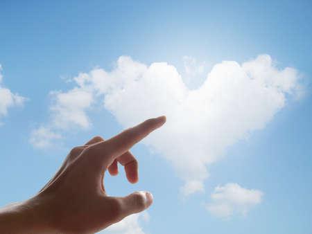 Hand point heart cloud Stock Photo