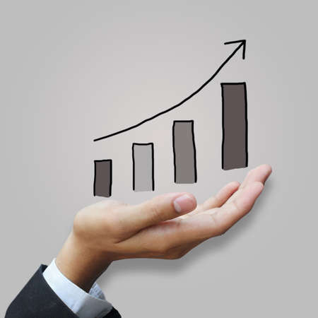 Growing graph in hand Stock Photo