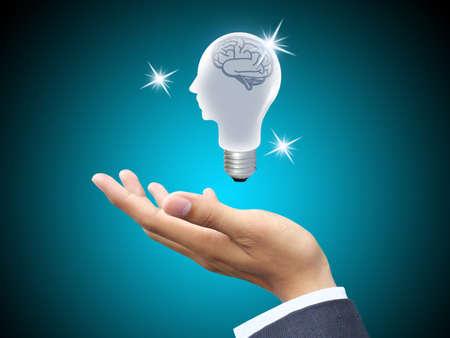 Hand holding light bulb head