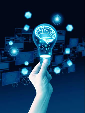 Hand holding light bulb brain Reklamní fotografie