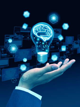 businesshand holding lightbulb