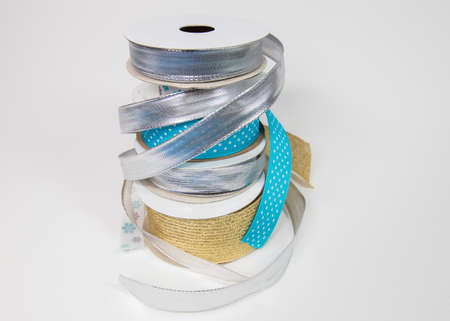 Stack of ribbons and spool of thread Stock fotó