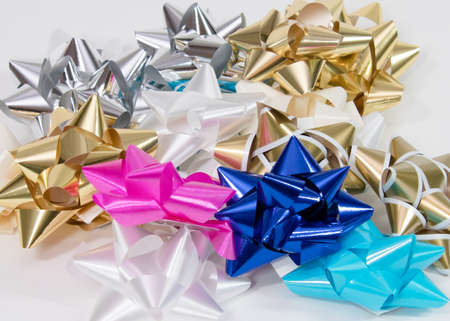Pile of colorful gift bows on white background