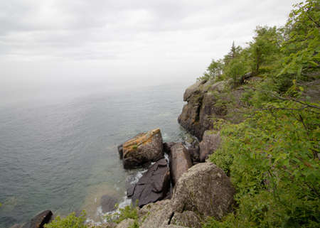 Rocky cliff on Lake Superior Stock fotó