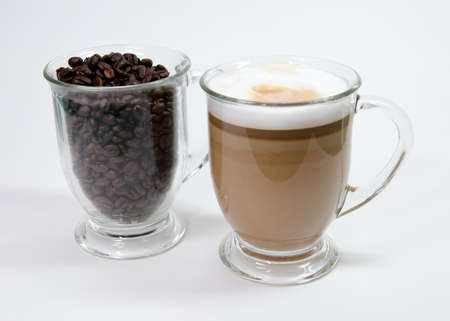 Latte in clear mug with coffee beans Stock fotó