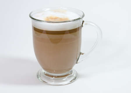 Latte in clear mug with foam Stock fotó