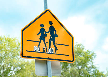 School crossing sign with go slow lettering
