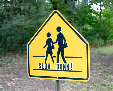 School crossing sign with slow down lettering Stock fotó
