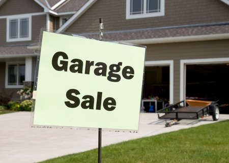 Garage sale sign in front of suburban home Stock fotó