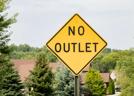 No outlet sign at entrance to suburban neighborhood