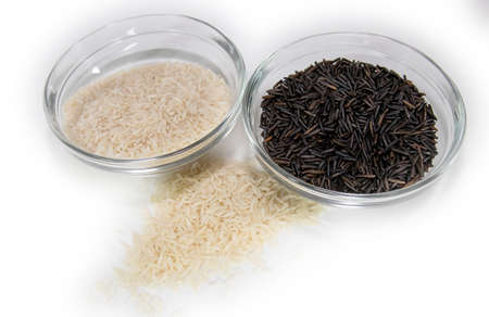 Clear bowls of uncooked basmati and wild rice