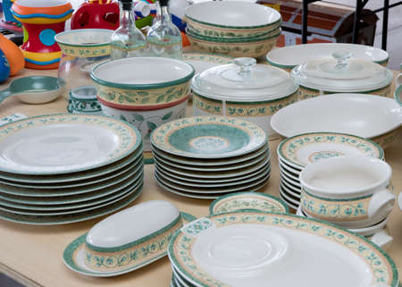 Collection of matching dishes for sale at a garage sale
