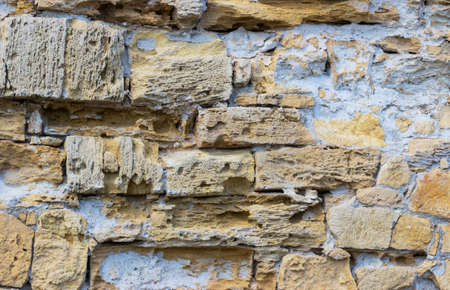 coquina: old rough wall made of brick and cement