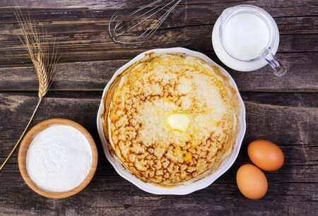 shake up: pancakes with oil on a wooden background Stock Photo