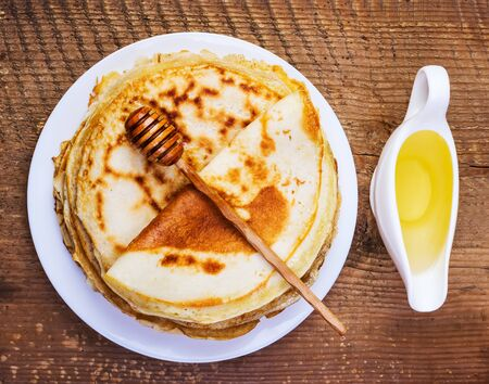 shake up: pancakes with honey on a wooden background Stock Photo