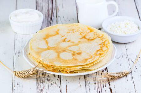 shake up: pancakes on a white wooden background Stock Photo