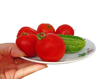 hand with tomatoes and cucumbers Stock Photo - 6660017