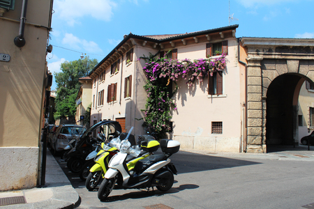 italian architecture: Verona, Italy, August 26, 2015, streets with floral balconies, typical urban italian architecture