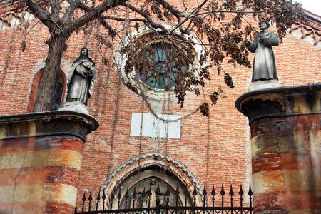 italian architecture: Statues in front of Santa Chiara church, Verona, Italy. Italian architecture detail