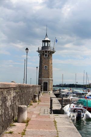 August 1, 2016, lighthouse on Garda Lake (Lago di Garda), Northern Italy. View from city of Desenzano del Garda on sunny summer day. Natural background. Landscape. Desenzano del Garda port. Editorial
