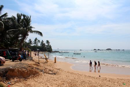 December 24, 2017, tourists and local people at  Hikkaduwa Beach in Hikkaduwa, Sri Lanka. Popular touristic asian destination. Seascape. Landscape. Vacation Editorial