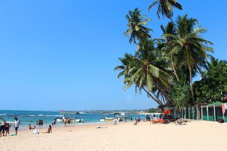 December 25, 2017, tourists and local people at  Hikkaduwa Beach in Hikkaduwa, Sri Lanka. Popular touristic asian destination. Seascape. Landscape. Vacation Editorial