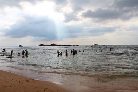 January 14, 2018, tourists and local people at  Hikkaduwa Beach in Hikkaduwa, Sri Lanka. Popular touristic asian destination. Seascape. Landscape. Vacation