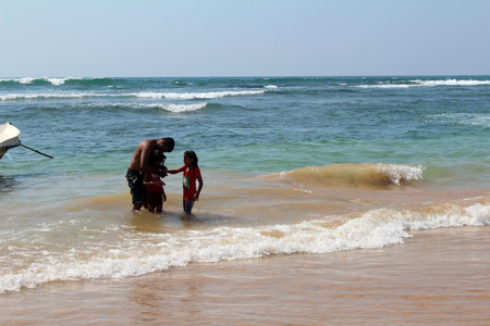 December 25, 2017, local people at the Hikkaduwa Beach in Hikkaduwa, Sri Lanka. Popular touristic asian destination. Seascape. Landscape. Vacation