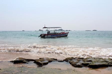 January 9, 2018, leisure boat at  Hikkaduwa Beach in Hikkaduwa, Sri Lanka. Popular touristic asian destination. Seascape. Landscape. Vacation