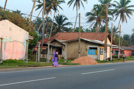 January 5, 2018, Hikkaduwa, Sri lanka. Hikkaduwa street with sri lankan people and  houses, typical sri lankan street view. Popular touristic asian destination. Hikkaduwa city view