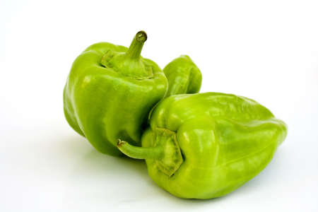 Two Fresh Cubanelle Peppers on White Imagens
