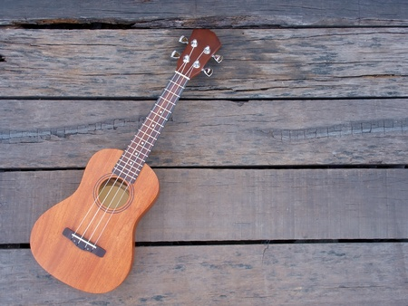 ukulele on old wooden photo