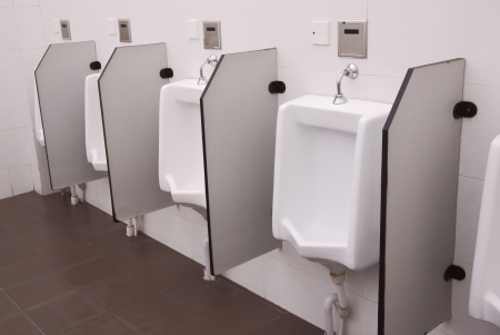 row of white toilets in men restroom  photo