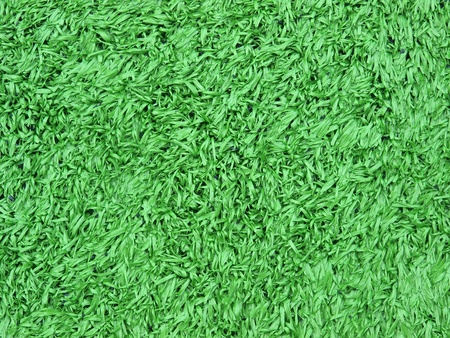 close up artificial turf on soccer football field  photo