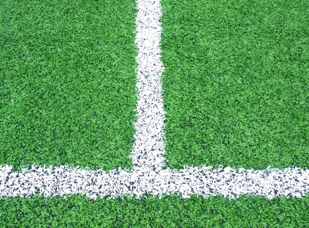 intersection of white line on soccer football field  photo