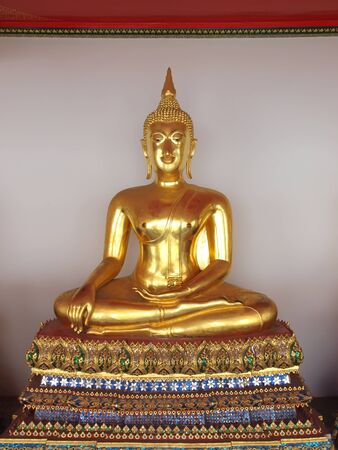 sitting golden budda in temple in thailand