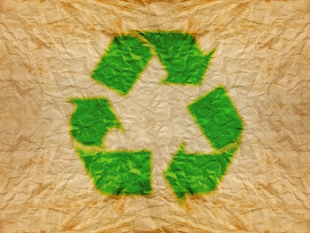 green recycle logo on old wrinkle paper