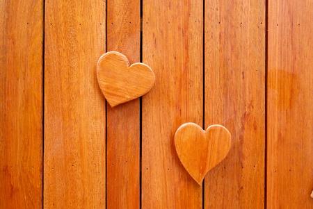 two wooden heart shape on wall