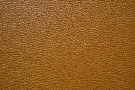 cracklier: brown artificial leather use for background Stock Photo