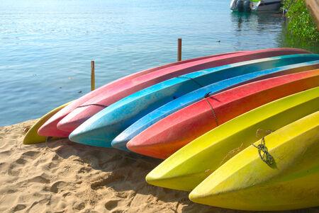 Row of Kayaks beside the sea